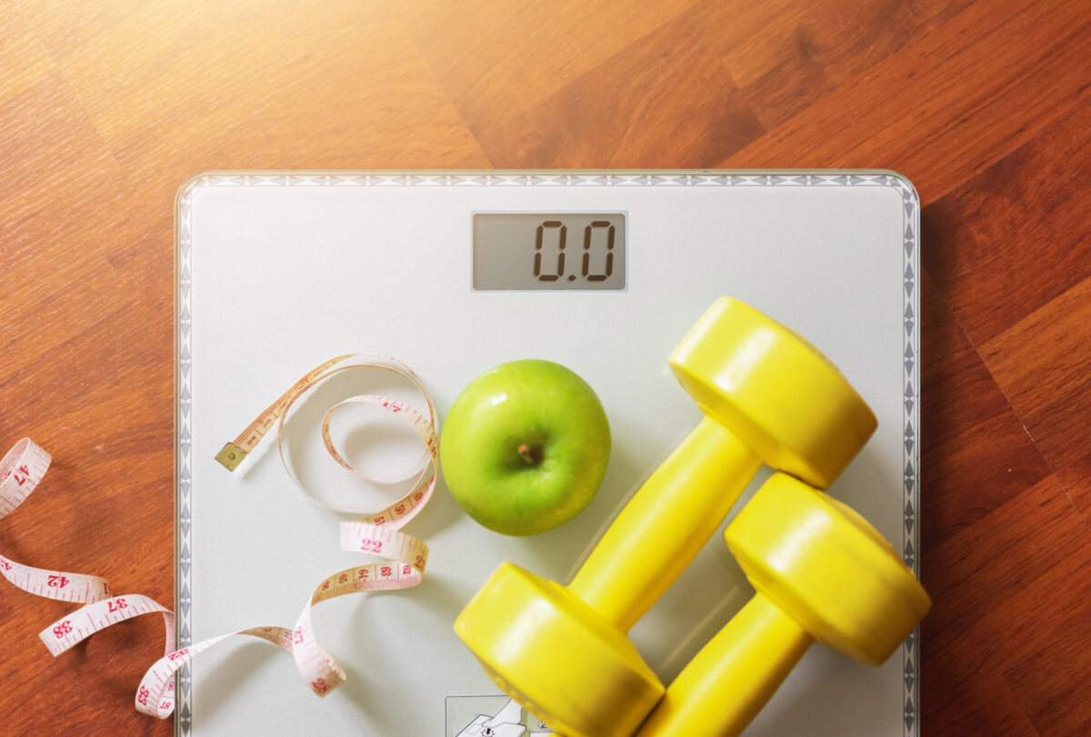 Photo of scale, dumbbells, measuring tape